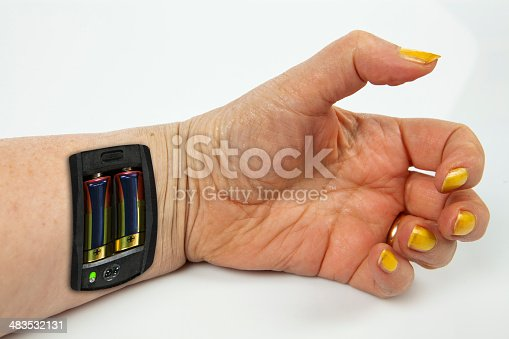 istock Robot - Insert the battery in an arm 483532131