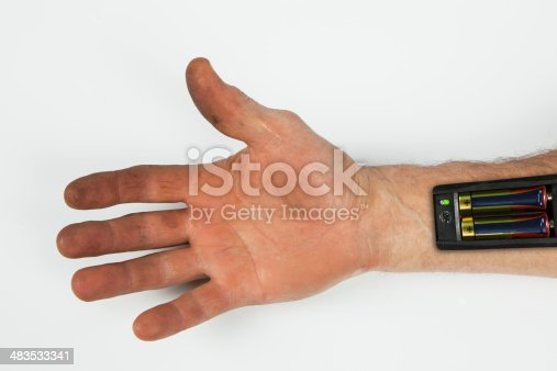 istock Robot - Insert the battery in an arm 483533341