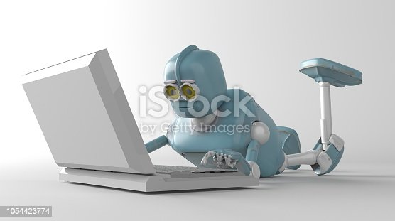 istock Robot is lying on the floor and working on a laptop 1054423774
