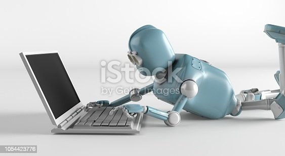 istock Robot is lying on the floor and working on a laptop 1054423776