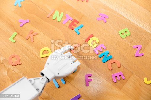 1042827770istockphoto robot is pointing with his finger to the word intelligence 947128898