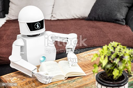 istock robot is reading some books and is showing his adaptive ai 947128248