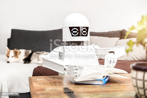 istock robot is reading some books and is showing his adaptive ai 947128250