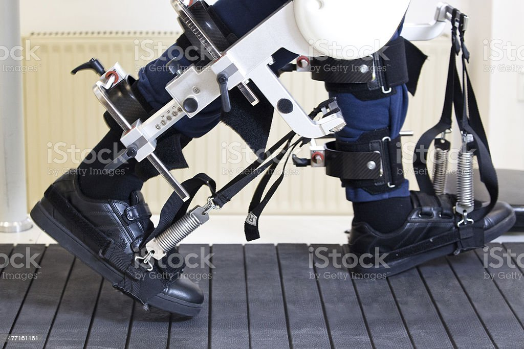Robot Machine Helping Disabled Man To Walk Again stock photo