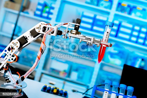 istock robot manipulates chemical tubes in the laboratory 525384953