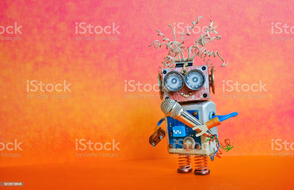 Robot microphone singing song. Music lecture performance poster design. Smiley face cyborg toy, red orange bright background, copy space royalty-free stock photo