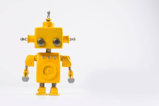 robot sobre un fondo blanco. - robot fotografías e imágenes de stock