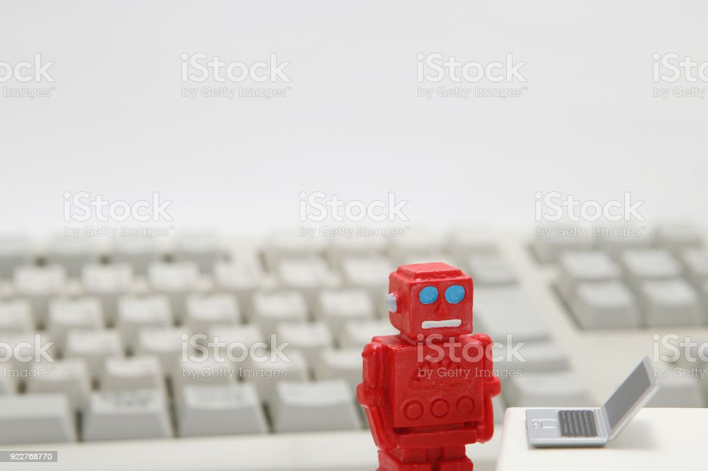 Robot or artificial intelligence and laptop with the keyboard on white background. stock photo
