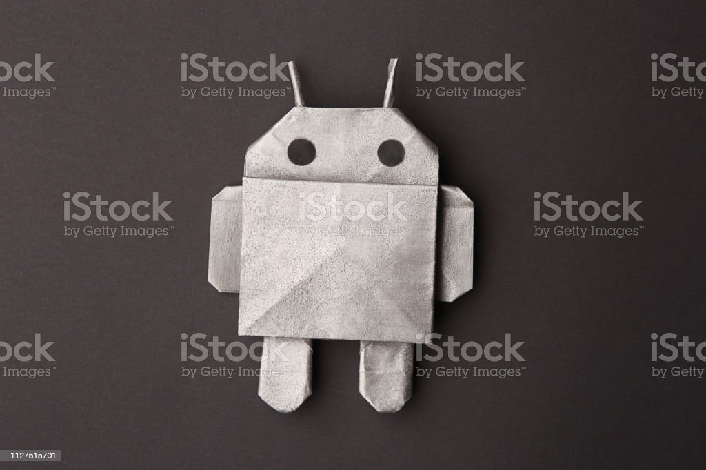 Robot origami on dark paper. - Royalty-free Adult Stock Photo