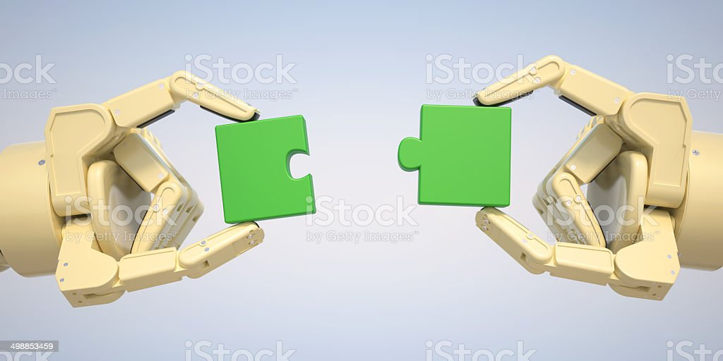 Robot puts jigsaw puzzle pieces together stock photo