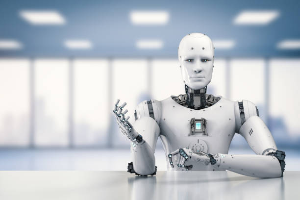 robot sitting behind table stock photo