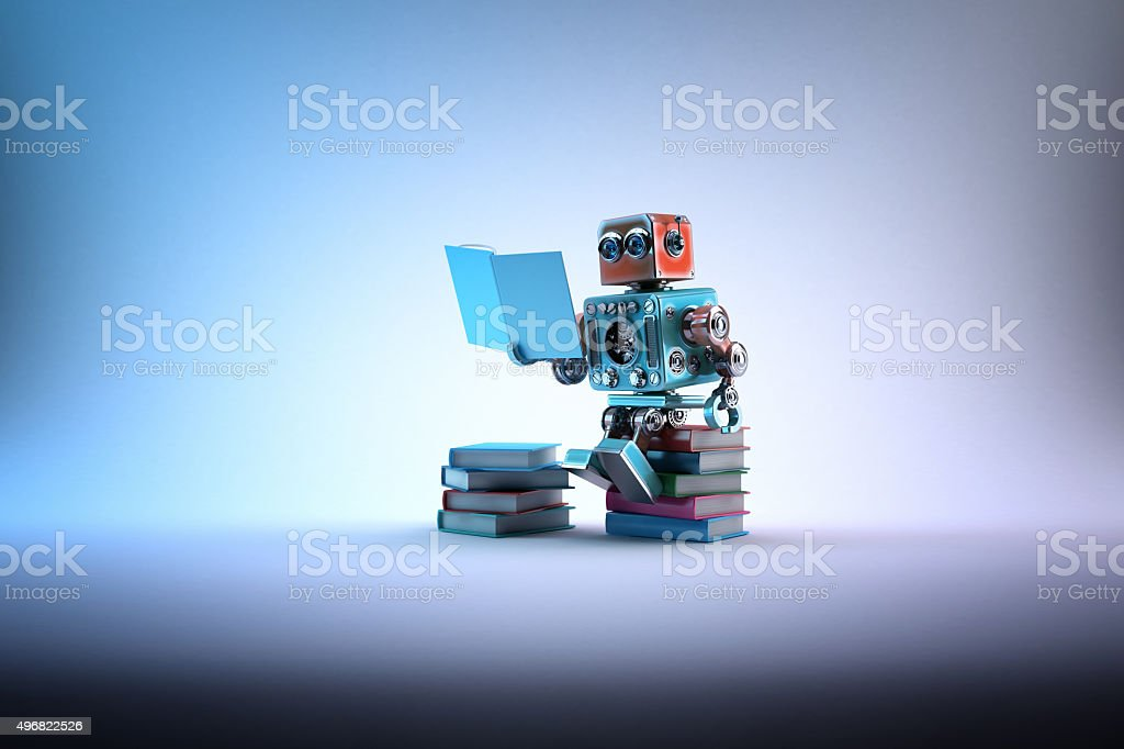 Robot sitting on a bunch of books. Contains clipping path bildbanksfoto