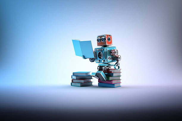 Robot sitting on a bunch of books. Contains clipping path stock photo