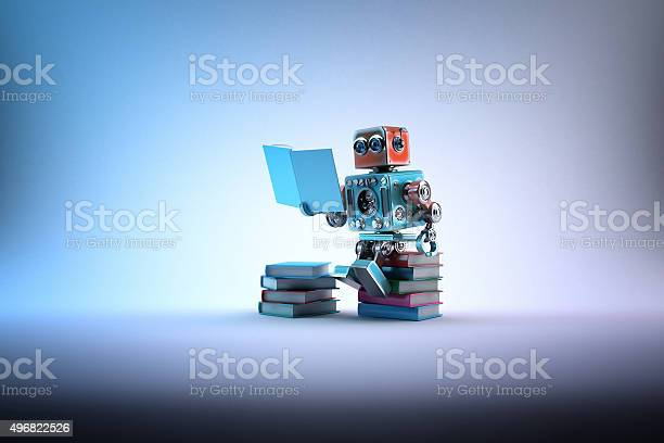 Robot Sitting On A Bunch Of Books Contains Clipping Path Stock Photo - Download Image Now