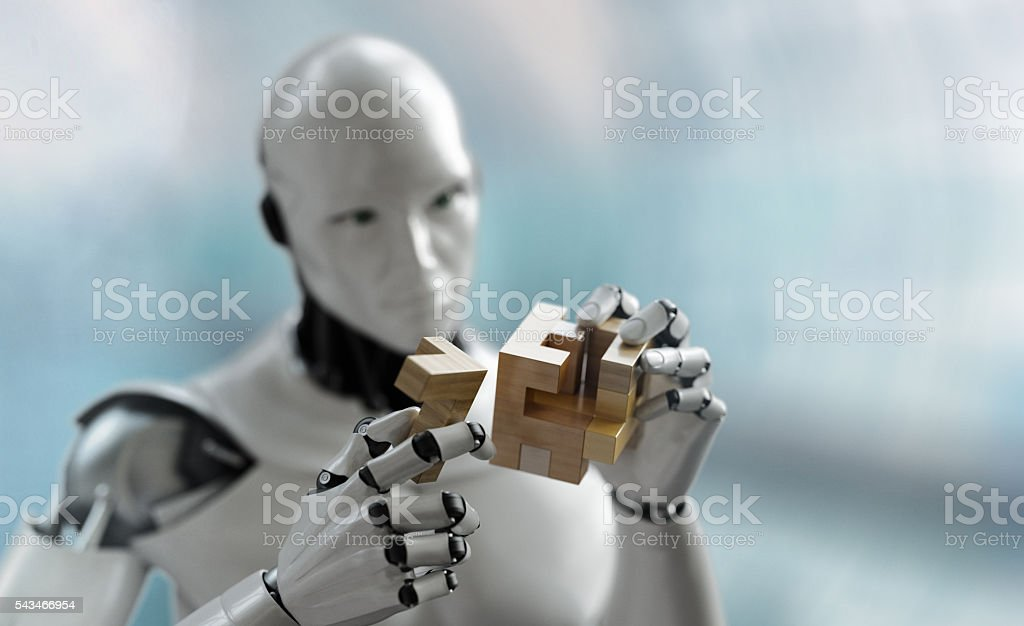 Robot solving a wooden puzzle stock photo