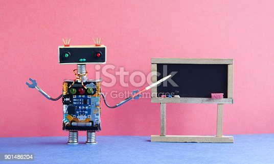 istock Robot teacher explains modern theory. Classroom interior with empty black chalkboard. Pink blue colorful background 901486204