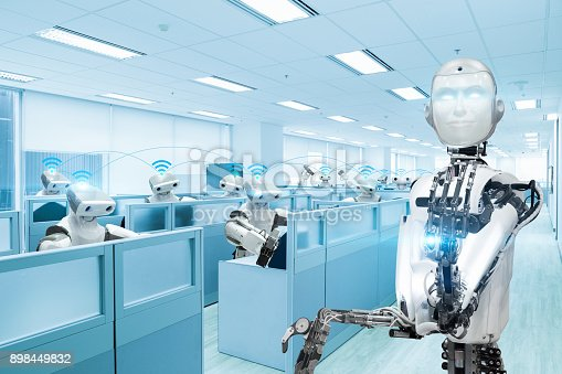 istock Robot team working in the office, Future technology concept 898449832