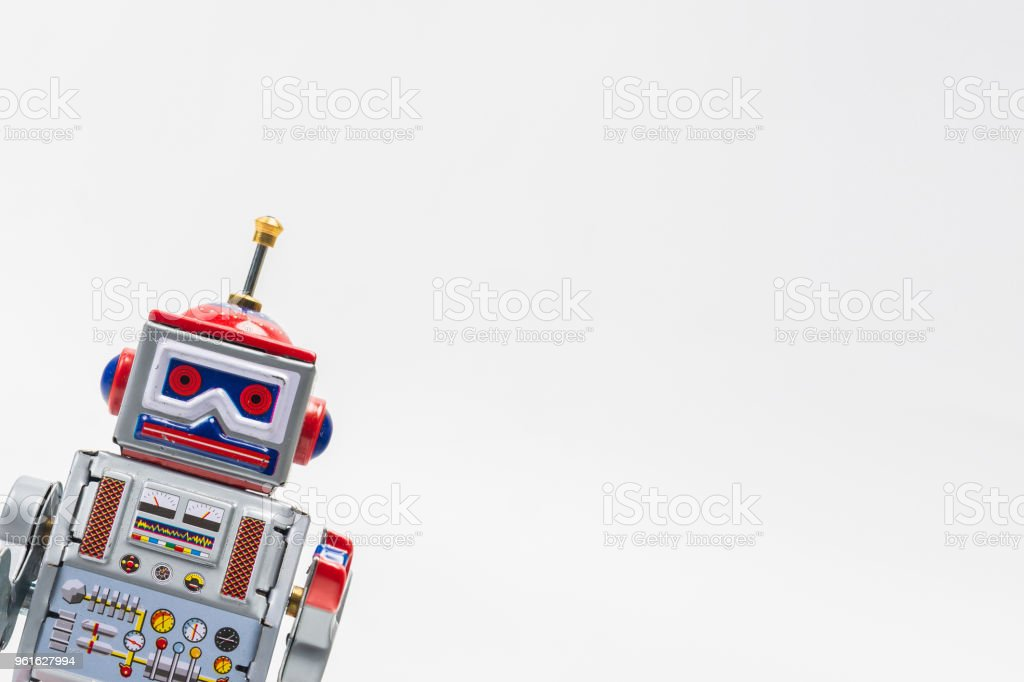 robot tin toy on white background . stock photo