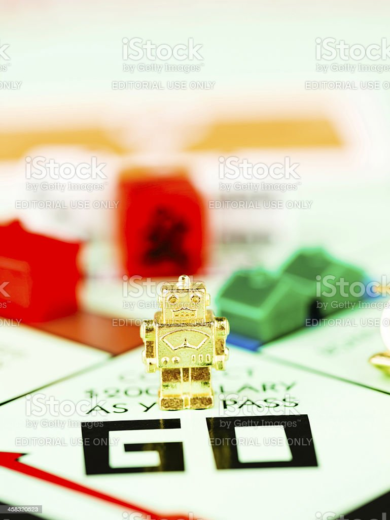 Robot Token on Monopoly Board stock photo