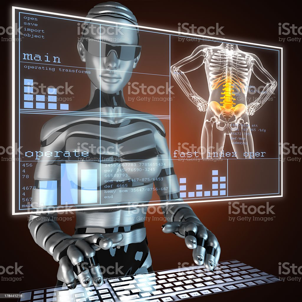 A robot typing on a keyboard and looking at human anatomy stock photo