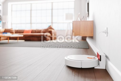 Close-up shot of a robot vacuum cleaner in a modern living room.