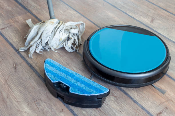 Robot vacuum cleaner with mopping functionality stock photo