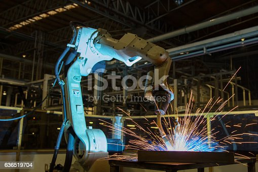 istock Robot welding in car factory 636519704