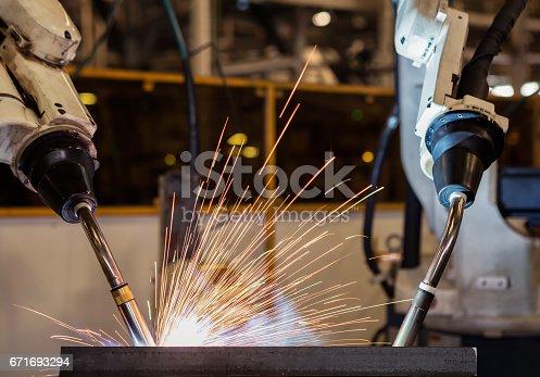 156642859istockphoto robot welding part in automotive industrial 671693294