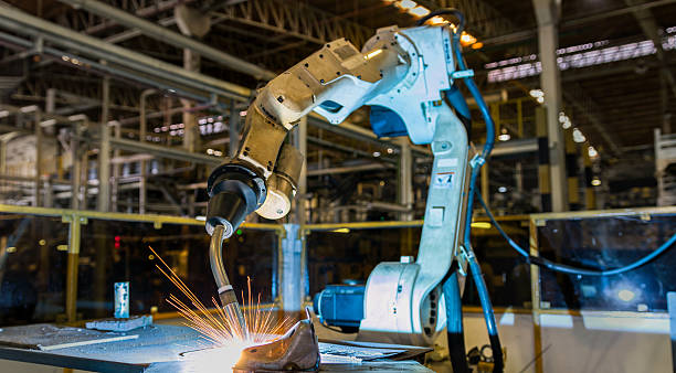 robot welding - automated stock photos and pictures