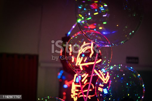 Robot with colorful balloons during a birthday party