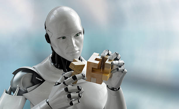 Robot with wooden puzzle stock photo