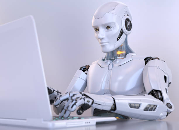 Robot working with laptop stock photo