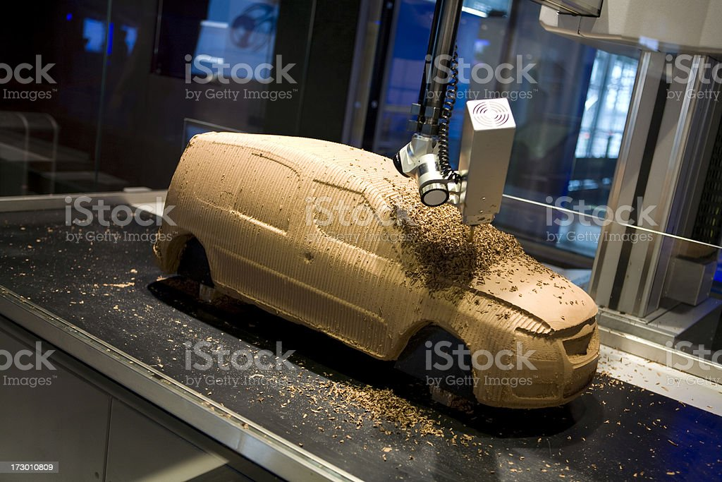 Robotic arm crafting a car royalty-free stock photo
