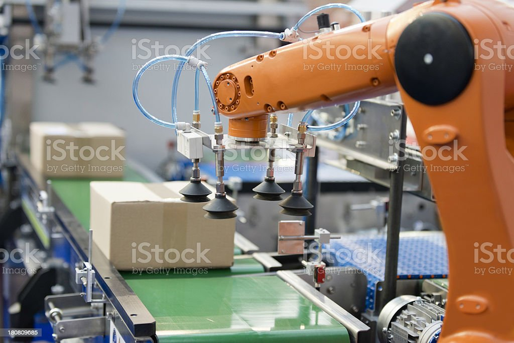 Robotic arm on a production line stock photo