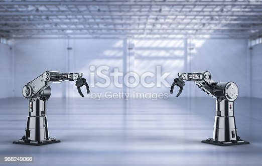 istock robotic arm or robot hand 966249066