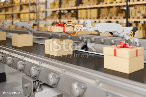 Robotic Arm Putting The Cover Of Gift Box On The Conveyor Belt