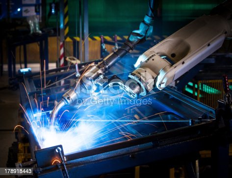 istock Robotic arm welding. 178918443