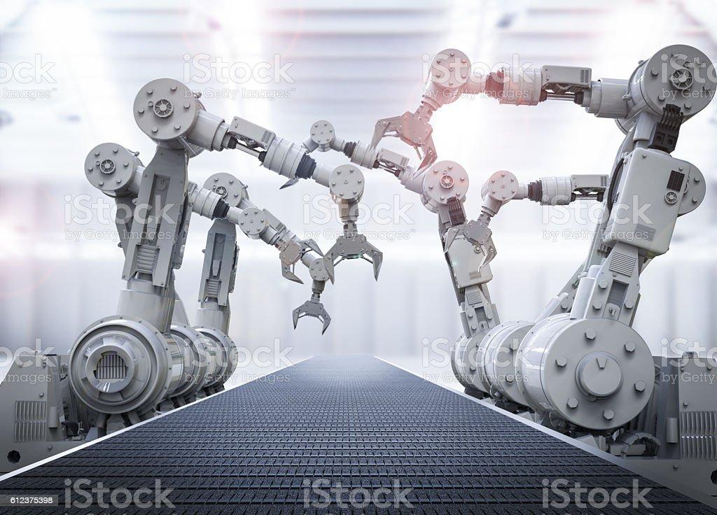 robotic arms with empty conveyor belt ロイヤリティフリーストックフォト