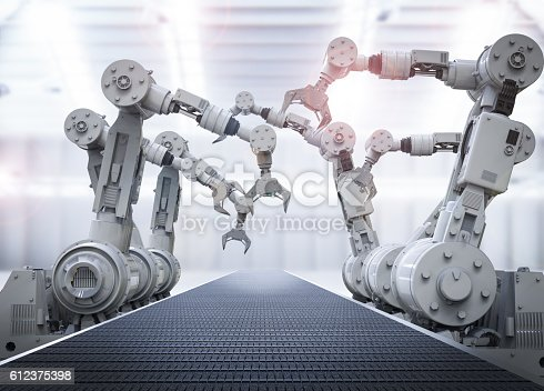 istock robotic arms with empty conveyor belt 612375398