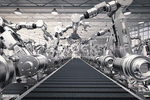 istock robotic arms with empty conveyor belt 620730028