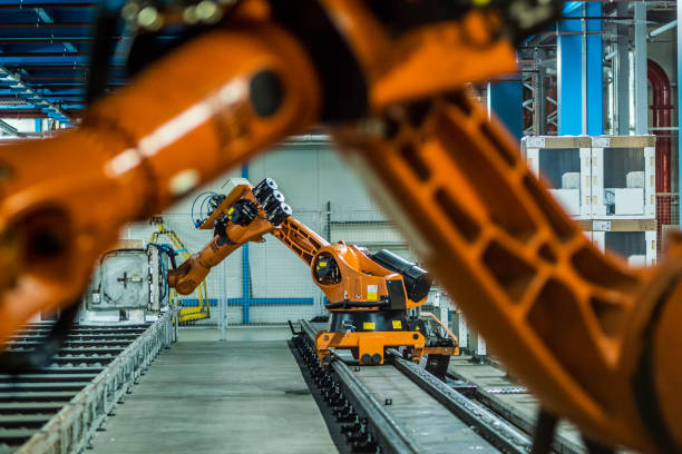 Robotic arms working on assembly line stock photo