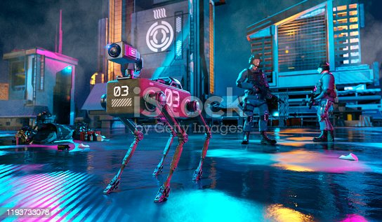 Concept of near future when robot dogs are used to assist police forces on assignments. The robot dog in the image has a camera mounted on top of the body. The dog stands in the middle of a city at night and two police men or two persons from the military standing in the background with weapons.