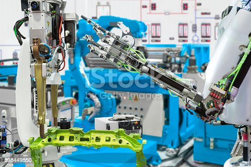 874298574 istock photo Robotic hand control robot industry in automotive manufacture, Future technology concept 898449850