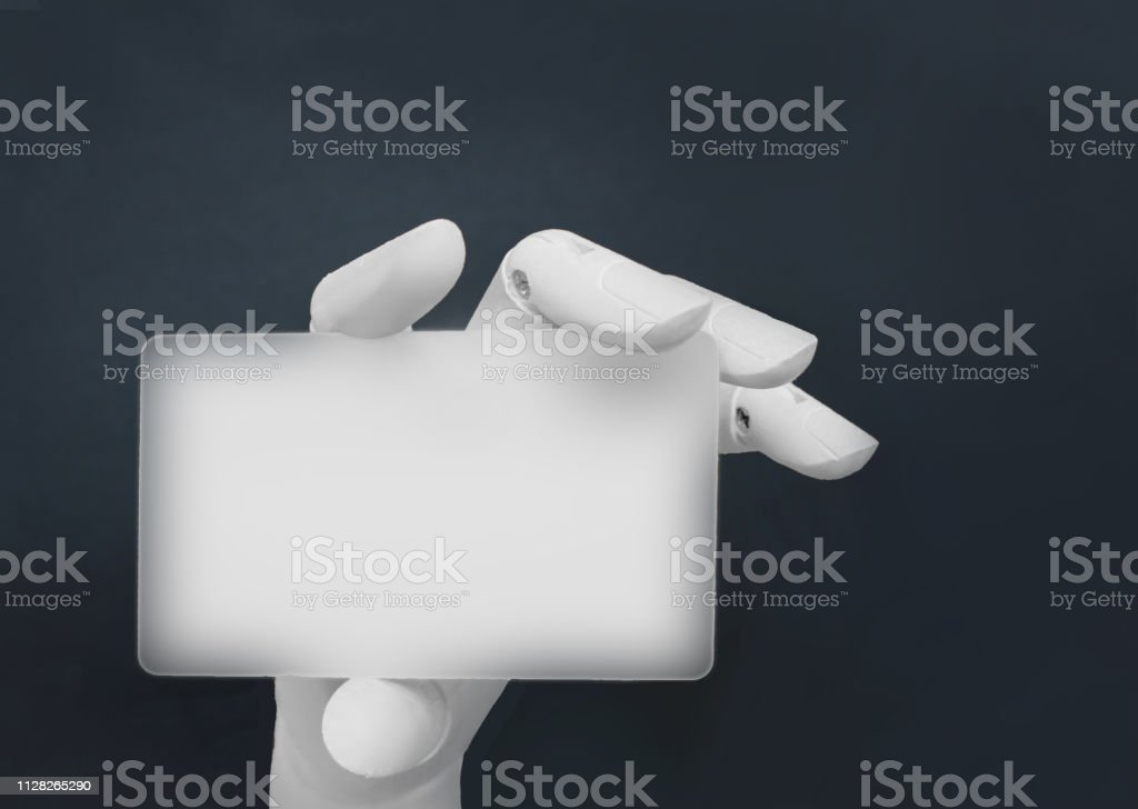 Robotic hand holding blank card stock photo