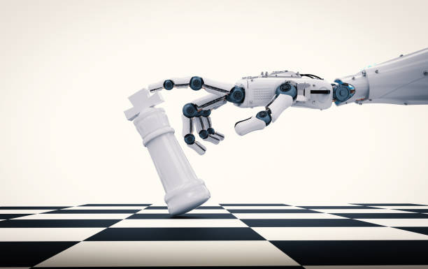 robotic hand holding chess king stock photo