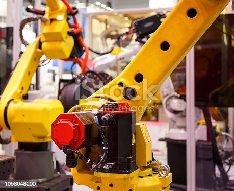 istock robotic hand machine tool at industrial manufacture factory, blur depth of field close-up 1058048200