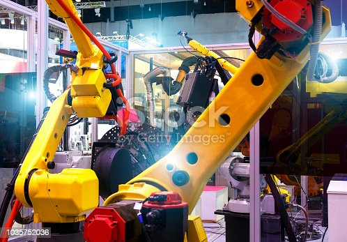 istock robotic hand machine tool at industrial manufacture factory. Production line of the plant, the depth of field 1035752036