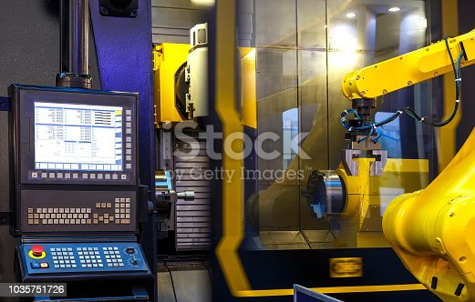 istock robotic hand machine tool at industrial manufacture factory 1035751726
