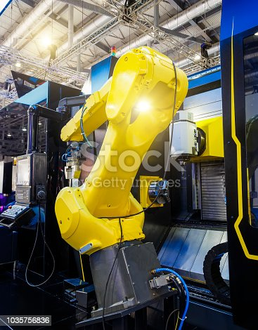 istock robotic hand machine tool at industrial manufacture factory 1035756836