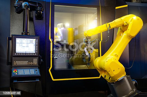 istock robotic hand machine tool at industrial manufacture factory working in conjunction with a numerically controlled machine 1058048146